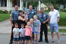 Ron Hendrickson poses with Madison, NJ Police and residents during 2017 National Night Out